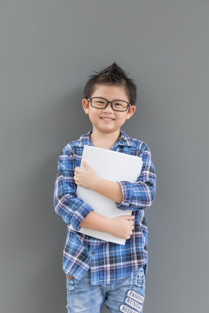 Asian boy feels happiness when time to school