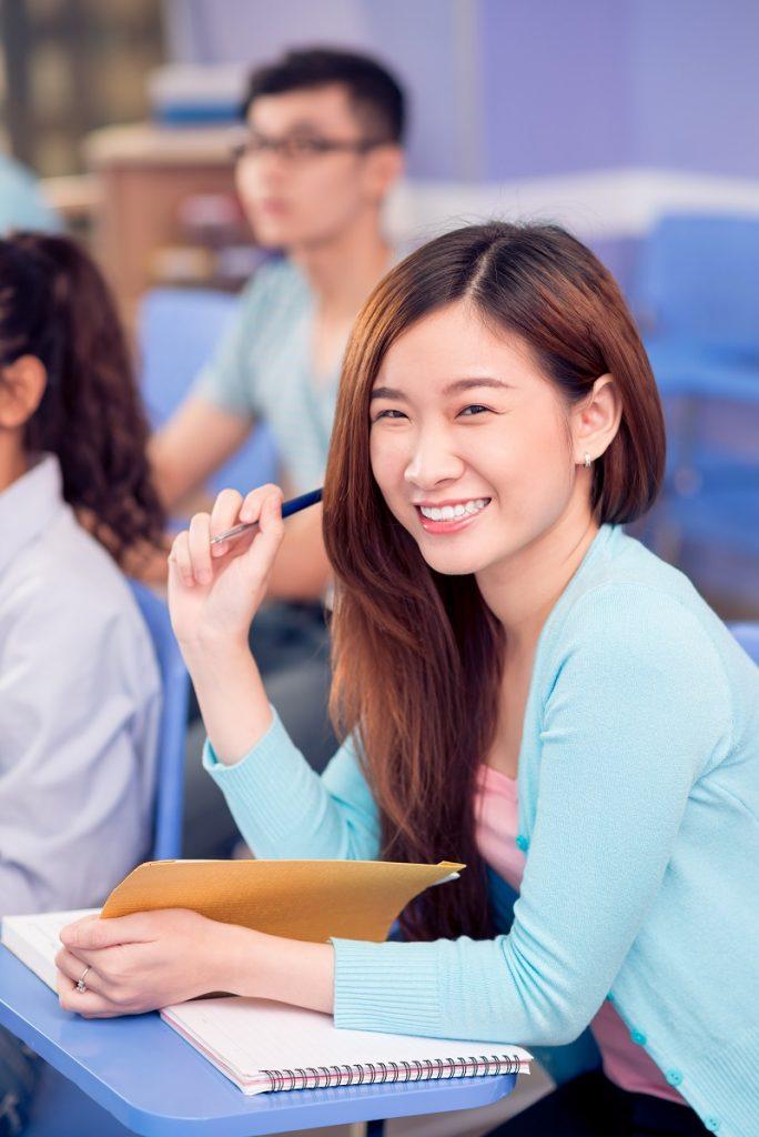 Vertical portrait of a schoolgirl smiling