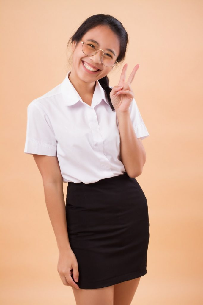 asian thai college woman nerd student in uniform