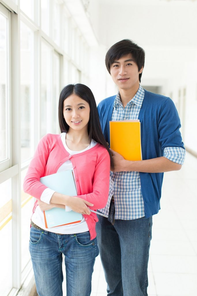 Asian college students holding books