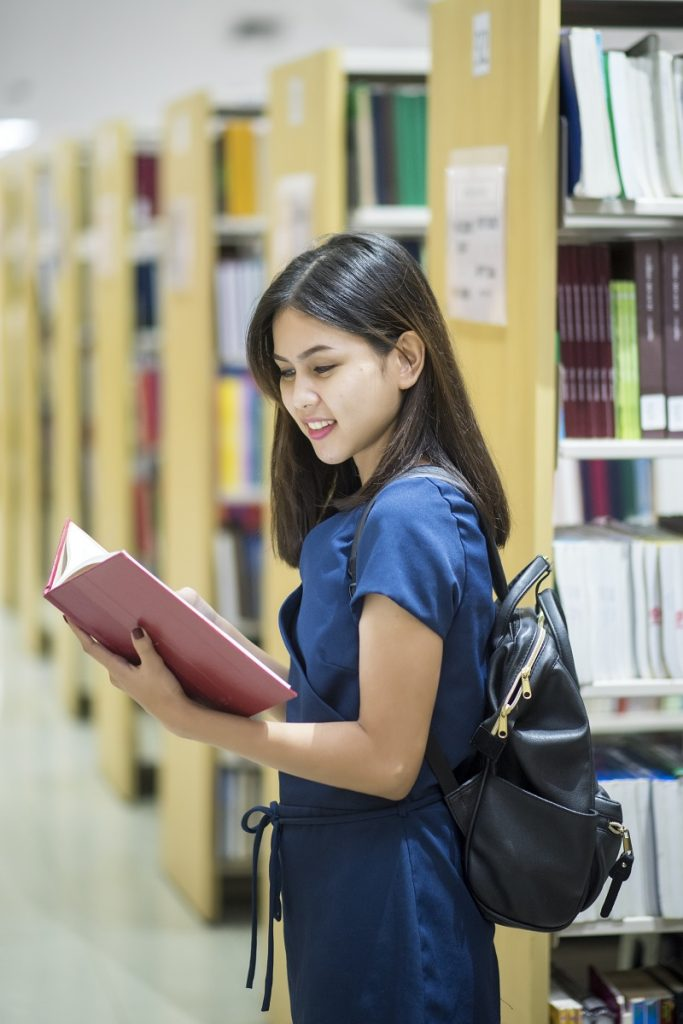 Beautiful women asian university student in library